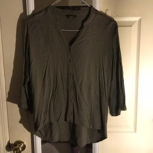 Green long sleeve blouse in size L